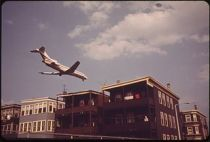 320px-NEAR_LOGAN_AIRPORT-AIRPLANE_COMING_IN_FOR_LANDING_OVER_FRANKFORT_STREET_AT_LOVELL_STREET_INTERSECTION_-_NARA_-_548446